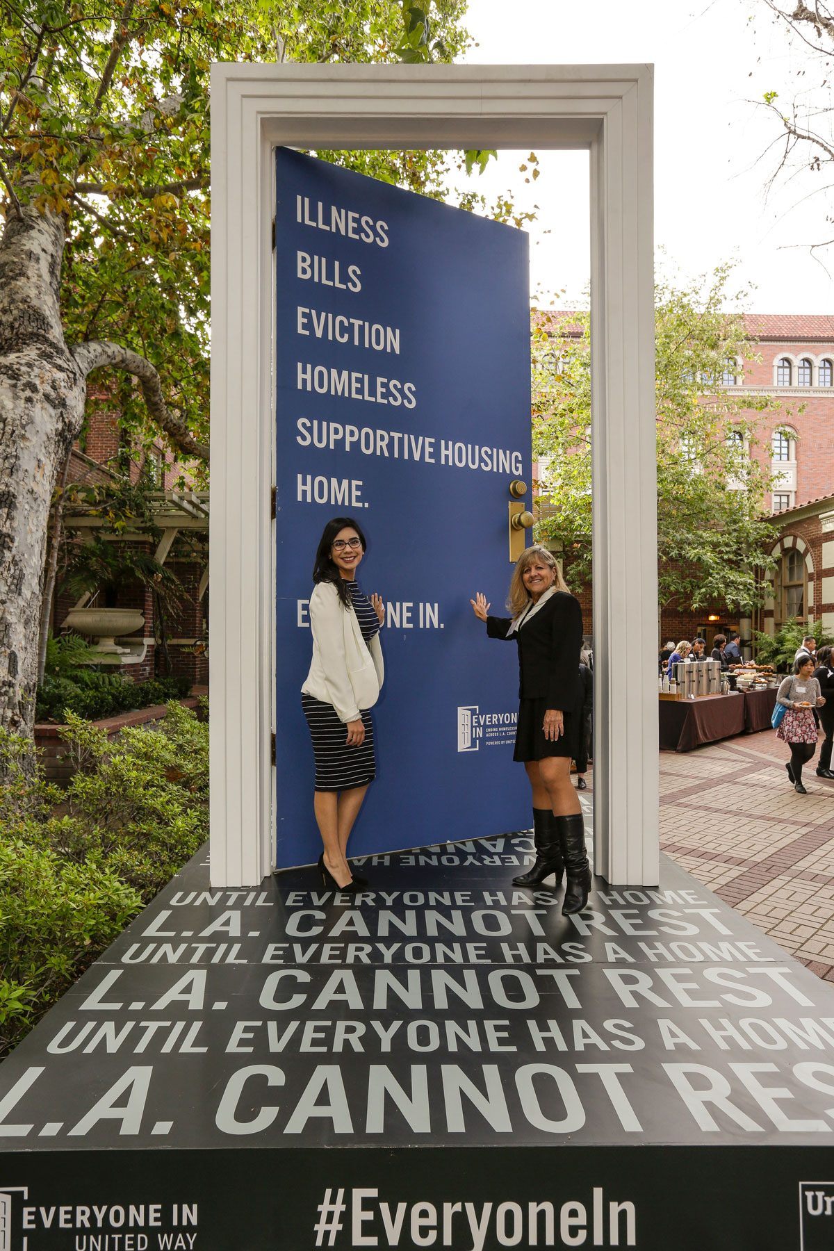 Celeste Rodriguez and Brenda Wiewel at the Ending Homelessness summit at USC