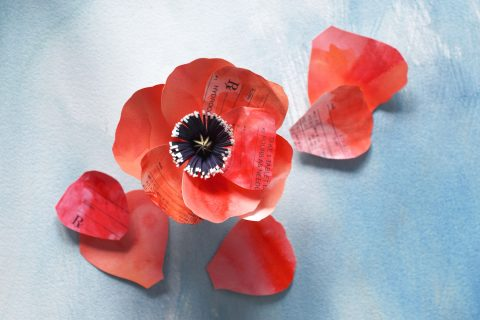 opioid addiction concept illustrated with prescription pad in shape of poppy
