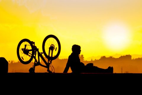 Physical fitness in America: Bicyclist takes a break