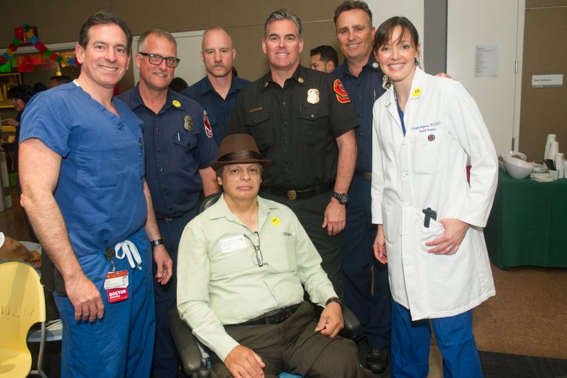 Hector Ruiz with the doctors that saved his life