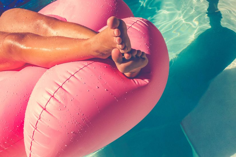 Tanning addiction: Tan person laying on a pool float
