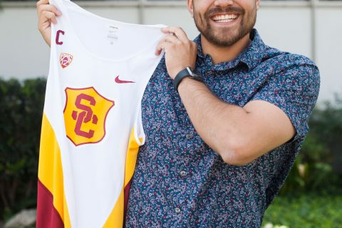 Using occupational therapy to help people with disabilities: Diego Lopez holds track uniform