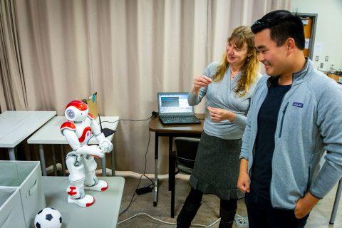 Eric Deng with robots