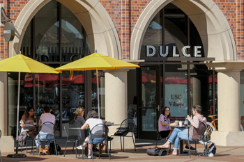 Students outside of Dulce in the USC Village.