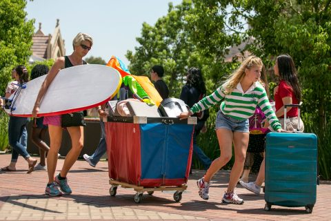 USC Move-in Day: Carrying a surfboard