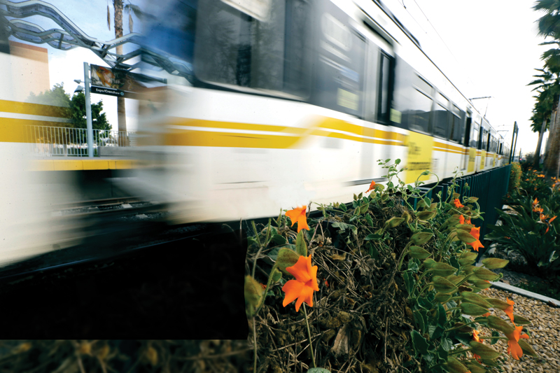LA Metro speeds by at Expo and Crenshaw Stop