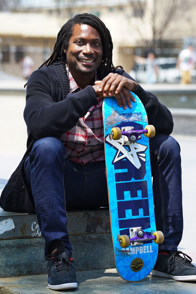 Neftalie Williams poses with his skateboard.