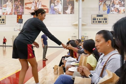 womens basketball trojan outreach