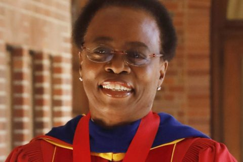 Photograph of President Wanda Austin at convocation in robes