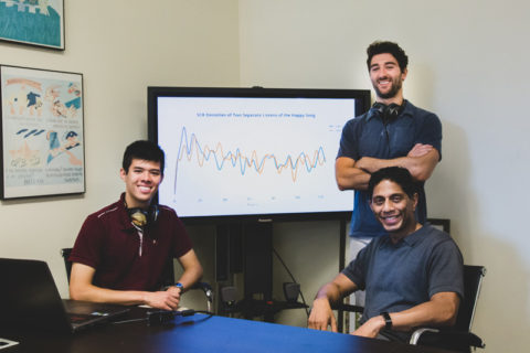 Viterbi researchers pose in front of line graph showing their research