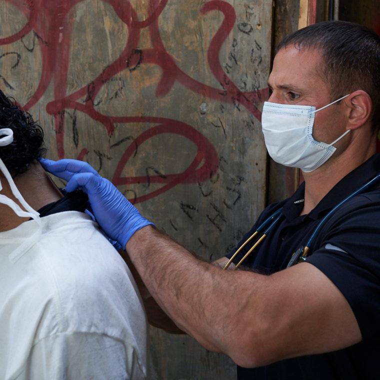 Street medicine specialist Brett Feldman with homeless man
