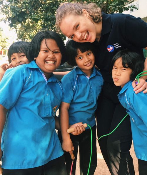 Sierra Drummond with group of young students in Thailand