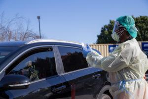 Keck staff by car at Drive-thru testing