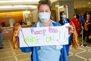 "Keck staff holding ""Keep the Fight On"" sign"