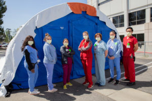 Keck staff in front of Medical Evaluation Tent