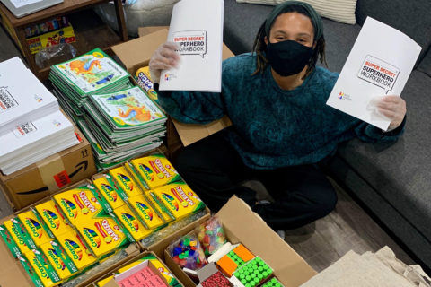 Sophie Sylla poses with the art kits she and co-founder Erika Ingram created as a part of their project, ARTS Justice. (Photo/Courtesy of Sophie Sylla)
