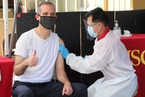 Eric Garcetti gets flu shot from Richard Dang