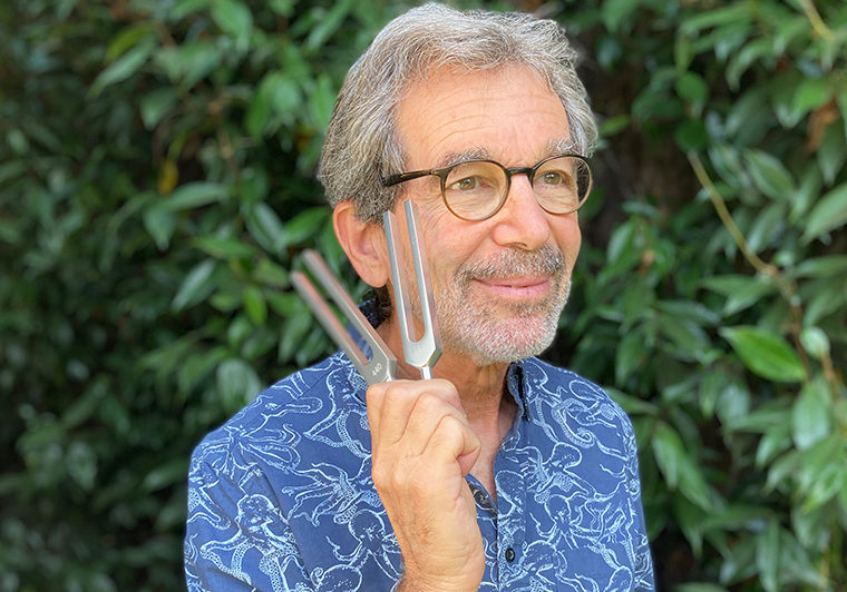 Jack Feinberg holds tuning forks.