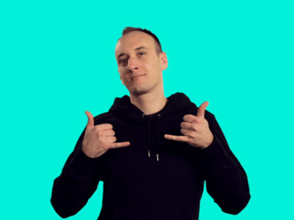"GIPHY Editor-in-Chief Tyler Menzel gives ""hang loose"" symbol with both hands"