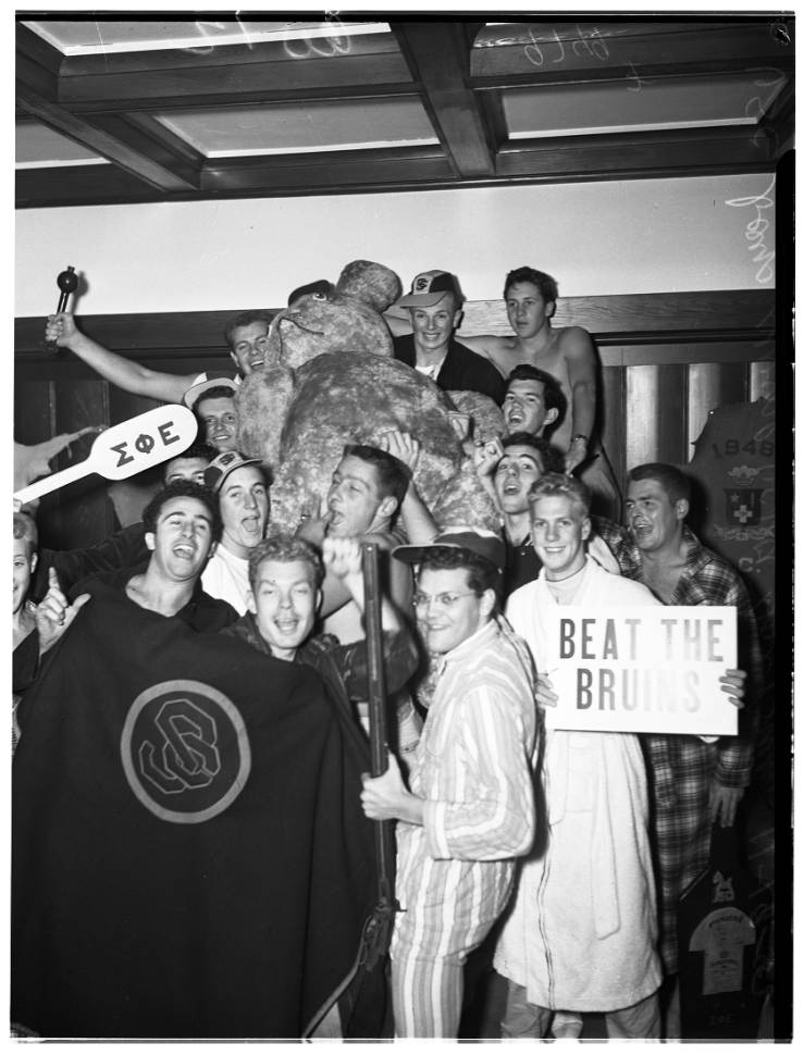 USC students pose with stuffed bear stolen from Bruin Theatre.