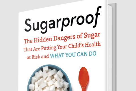 Cover of Sugarproof book showing a bowl of sugar cubes and a red spoon.