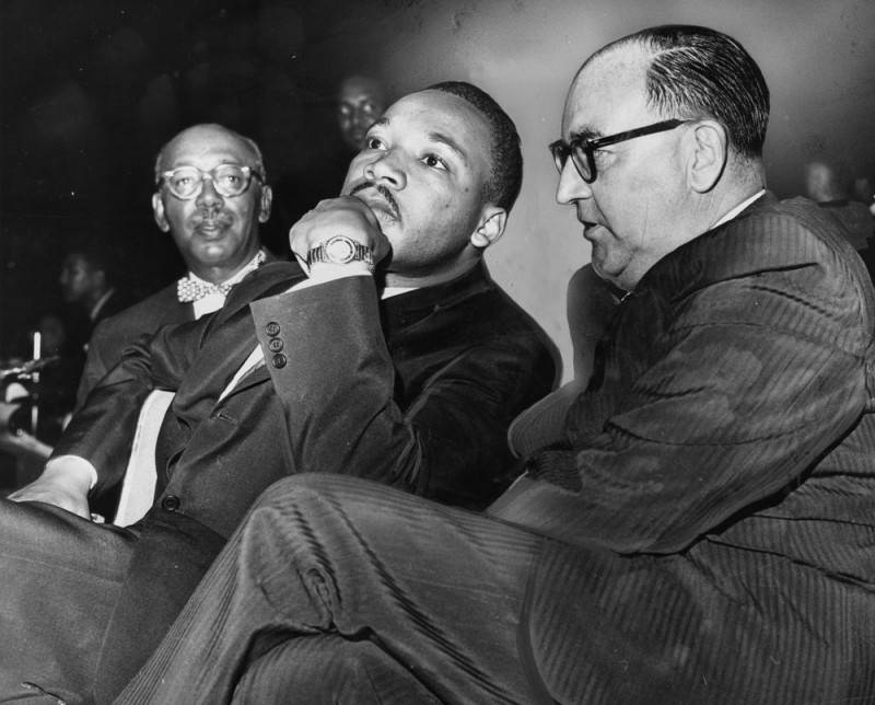Martin Luther King Jr. sits next to California Gov. Edmund Brown at a freedom rally at the Los Angeles Sports Arena.