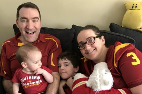 Current image of Elizabeth Kuhn and Andrew Green with their two children and a second image of them in their Trojan Marching Band uniforms.