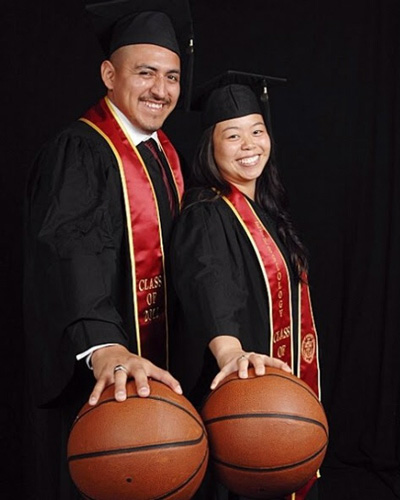 Dahliena and Bryan Chavac in USC graduation caps, gowns and sashes, each palming a basketball.
