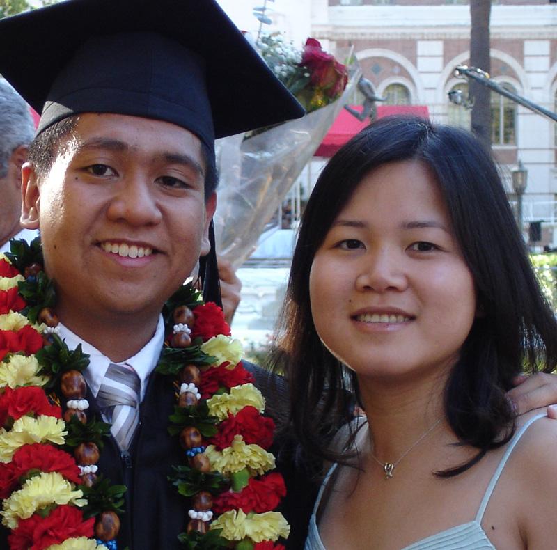 Michael Odoca in graduation cap and lei with his arm around Teri Tran.