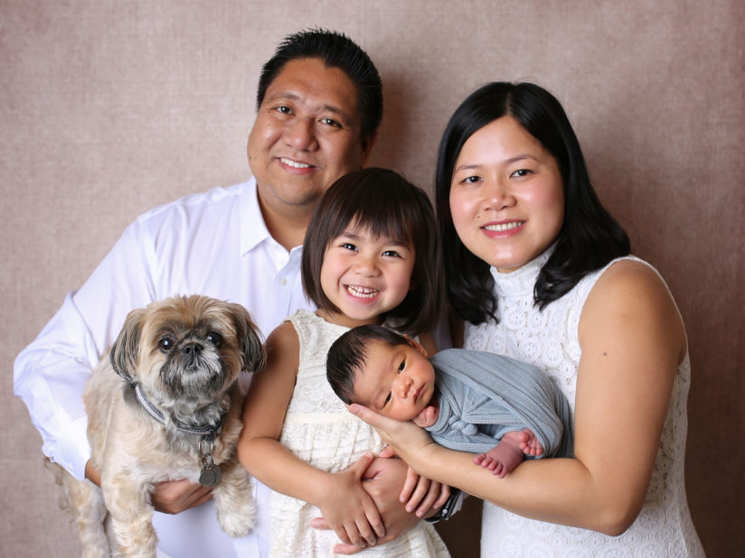 Family photo of Michael and Teri Odoca; their two children, Madison and Cameron; and their dog.