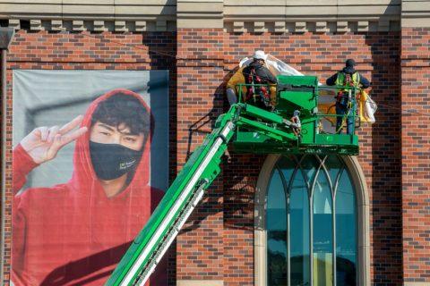 Banner installation on Fertitta Hall