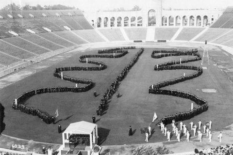 USC graduate procession across Coliseum field