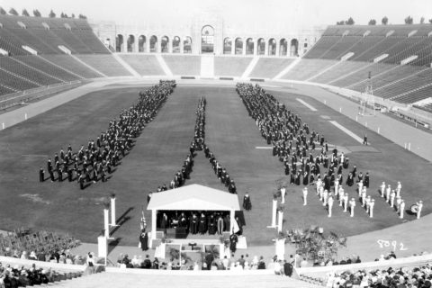 USC graduates march toward a stage on the Coliseum field