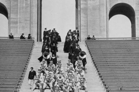 marching band leading USC graduation through peristyle