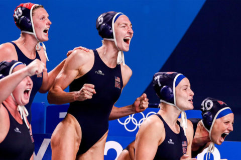 Women's water polo players cheer