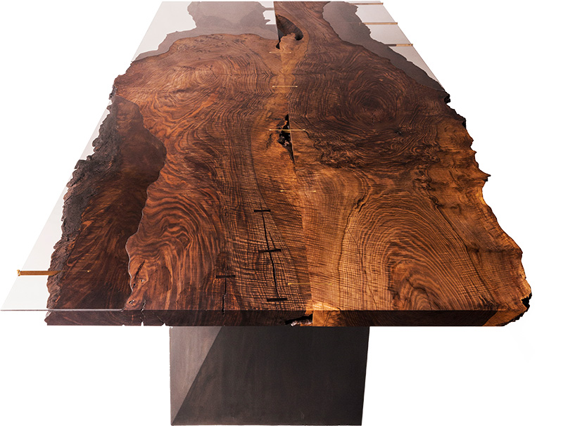 The Corset Table is made with a glass top that shows the wood's natural grains