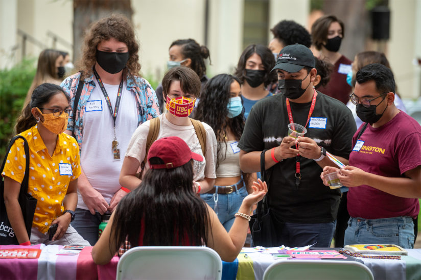 Students visit LGBTQ+ table: USC'sStudent Equity and Inclusion Programs