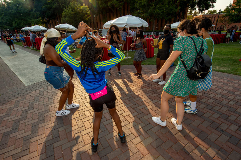 Students dancing at welcome dinner
