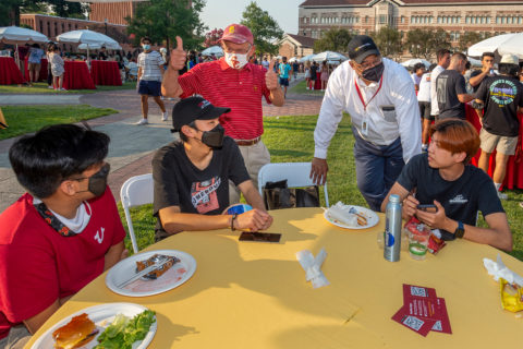Charles Zukoski and WInston Crisp visit with students during welcome dinner