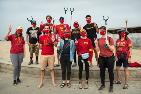 USC alumni day of scervice volunteers on beach
